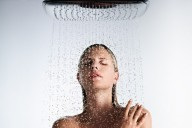 hg_raindance-select-overhead-shower_showering-woman-close-up_serge-guerand_1154x650_rdax_730x411