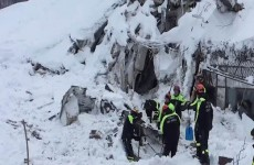 A photo taken from a video shows firefighters work at Hotel Rigopiano in Farindola