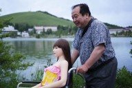 "NAGANO, JAPAN - JUNE 4: Senji Nakajima takes a walk with his Love Doll ""Saori"" at lake Suwa on June 4, 2016 in Nagano, Japan. Senji Nakajima, 61 years old, lives with his life-size 'love doll' named 'Saori' in his apartment in Tokyo, Japan. Nakajima, married with two children, who lives away from home for work, first started his life with Saori six years ago. At first, he used to imagine as if the doll was his first girl friend, and used it only for sexual purposes to fill the loneliness, but months later, he started to find Saori actually has an original personality. ""She never betrays, not after only money. I'm tired of modern rational humans. They are heartless,"" Nakajima says, ""for me, she is more than a doll. Not just a silicon rubber. She needs much help, but still is my perfect partner who shares precious moments with me and enriches my life.""  (Photo by Taro Karibe/Getty Images)"