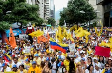 Venezuelan opposition activists take part in a peaceful demonstration in Caracas, against the government of President Nicolas Maduro, on September 19, 2015.  AFP PHOTO / FEDERICO PARRA